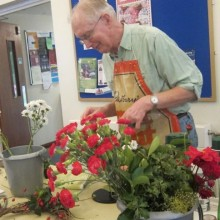 Alan Page was busy arranging flowers at the Christmas Fayre at St. Martin.
