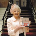 Carolyn Darbyshire MBE, June 2013 at Buckingham Palace.