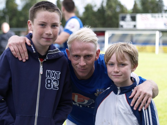 My grandsons Josh (left) and Cole (right) with Eastleigh FC captain Glen Southam.