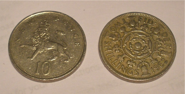 "Ten new pence and the same-sized two shilling (""florin"") coins."