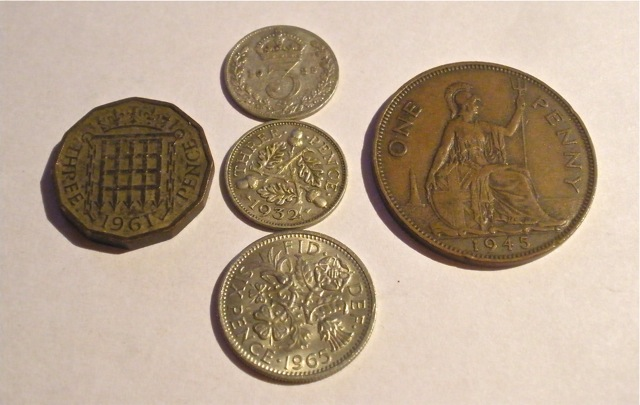 "Some pre-decimal coins: a twelve-sided threepenny (thrupenny) bit, introduced in the early 1940s; two even older threepenny ""joeys""; a sixpence (""tanner""); and the well-known Britannia penny."