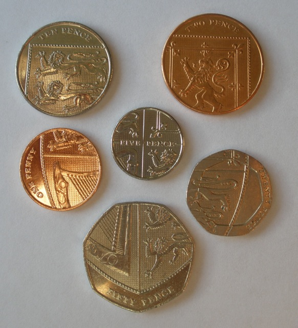 New coins features the coat of arms of the English crown.