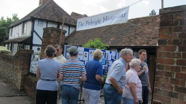 Pirbright villagers reading about history of local families and Pirbright during the war.