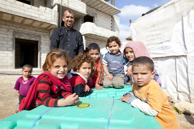 Syrian children with their box