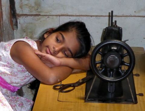 Sweatshop? Not really; just a bored schoolgirl in her father's workshop