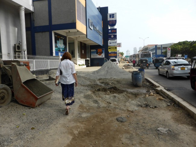 Rebuilding Colombo. Even the footpaths become an assault course.