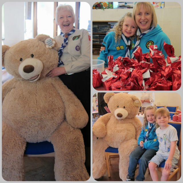 Fundraising for Second Chandler's Ford Ramalley Scout Group. (Left) Carolyn Darbyshire MBE; Heather and daughter Millie; Millie, Harvey, and the bear.