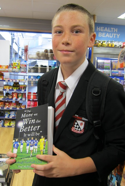 Josh shows me the new Eastleigh FC book, which uses pictures taken by his granddad, Tony Smith.