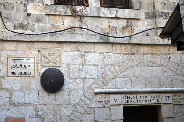 "The Via Dolorosa is a street within the Old City of Jerusalem, held to be the path that Jesus walked, carrying his cross, on the way to his crucifixion. Image by <a href=""https://www.flickr.com/photos/michaelcjones/15665581966""> Michael Jones </a> via Flickr."