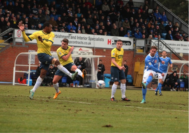 Brian Howard's effort on goal is saved by the Torquay keeper.