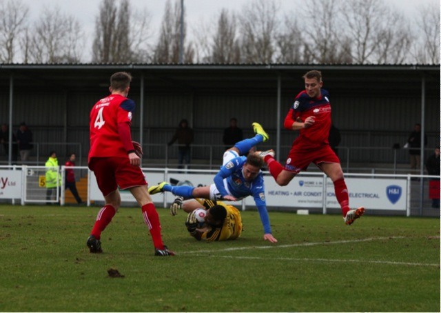 Eastleighs Brian Howard goes over in the box but nothing is given.
