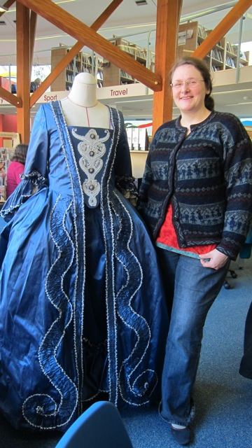 Costumier Helen McArdle showing her 1760s dress called a Mantua.