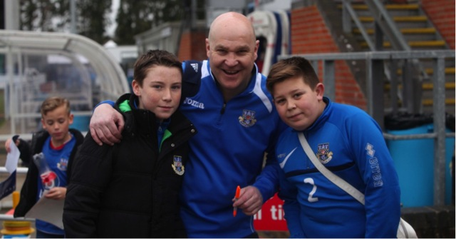 A delighted Richard Hill (Eastleigh Manager) has a few moments with two of Eastleigh's Under 13 players after the game.Eastleigh 4 Macclesfield Town 0; 12:45 Saturday February 28th 2015