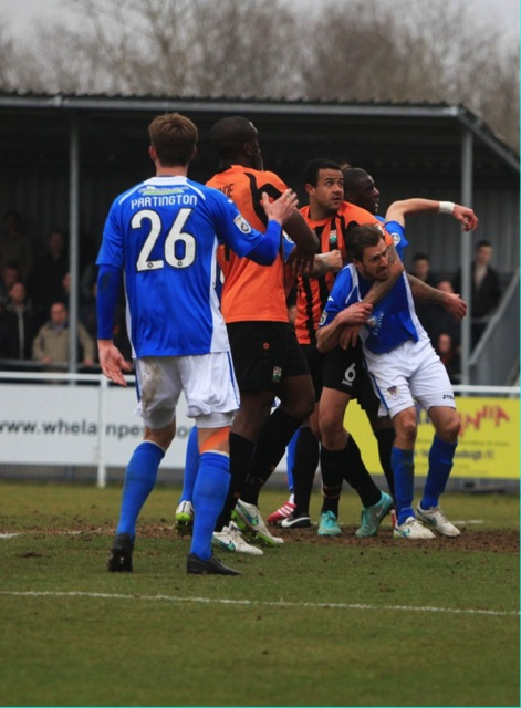 Barnet's No 6 David Stephens holds Eastleigh Jack Midson but it goes unpunished.