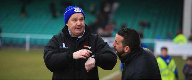 Eastleigh's manager Richard Hill asks the 4th official how much of the 6 minutes added time was actually played.