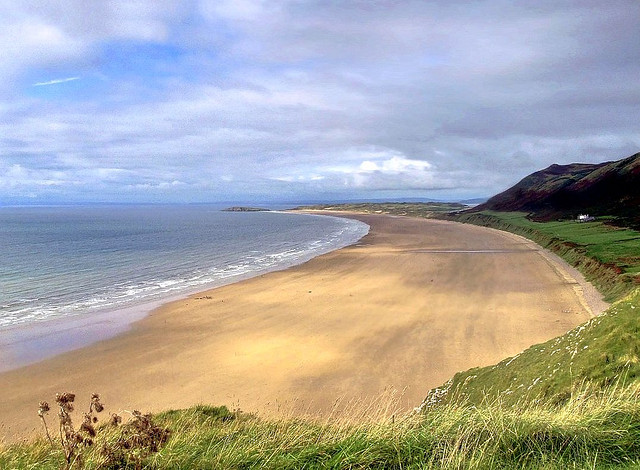 "Rhossili Bay, The Gower, South Wales image by <a href=""https://www.flickr.com/photos/james7/2815057509""> James Hetherington</a>  via Flickr."