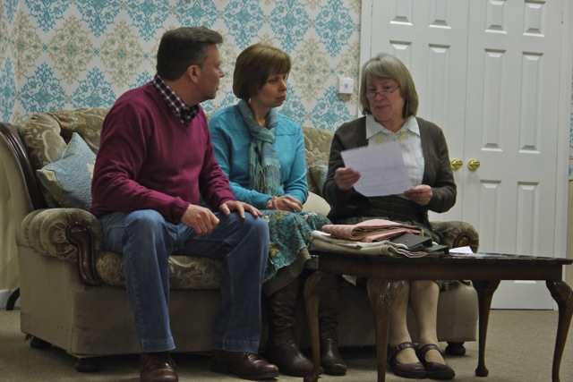 Right: Lady Gertrude Synclaire (played by Helen Dunn) reading a letter from Lady Astoria Featherstone to Timothy (Mike Slatcher), and Ginnie (Christine Slatcher). Worth a Fortune: Farcical comedy, MDG Players, spring, 2015.