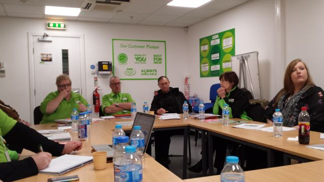 Community Life Champions' meting taking place at the Community Room.