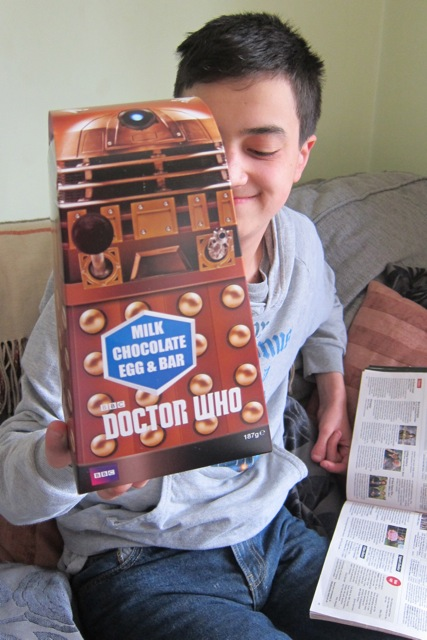 A Dalek Easter egg makes a teenager very happy.
