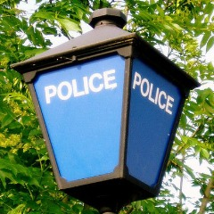 Police lamp image adapted from image by J D Mack via Flickr.