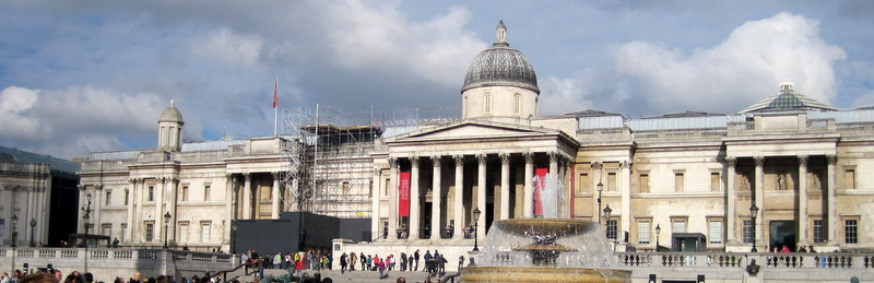 The National Gallery from Trafalgar Square. A long building.