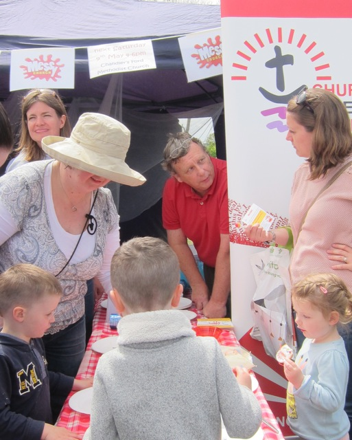 Promoting Messy Church of the Methodist Church at the Fryern Funtasia 2015.  (Man in red shirt: Youth worker John Andrews)