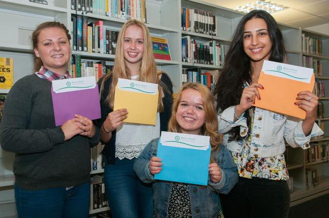 Barton Peveril College Students (l to r) Katie Jones, Emily York, Emily Williams and Bahar Esfandiari. The ex Thornden School pupils were all celebrating good A Level results. Thursday 13th August, 2015. Image: Andy Brooks.