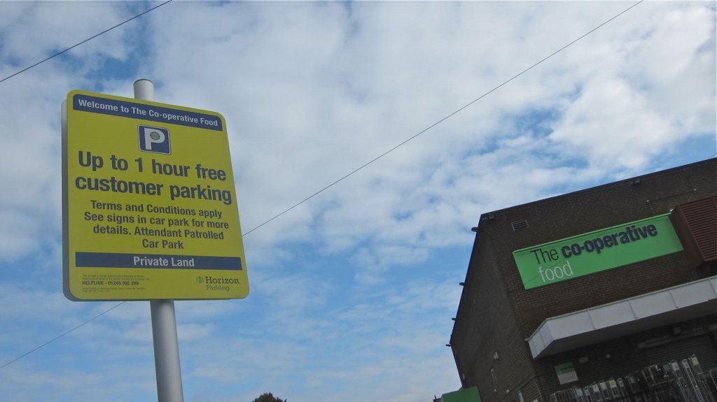 Sign about one-hour parking at Co-op carpark, near Fryern Arcade, Chandler's Ford.