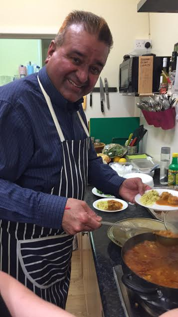 Raj preparing curry using his own Gold Dust ingredients at Bay Leaves Larder. At Chandler's Ford