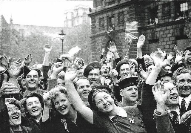 Jubilant crowds in Parliament Street celebrate the end of the war in Europe on the 8th May 1945. Image by Leonard Bentley via Flickr.