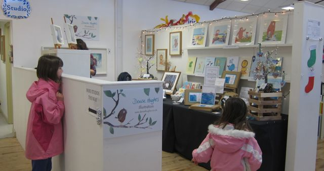 The display of  Illustrator Denise Hughes.