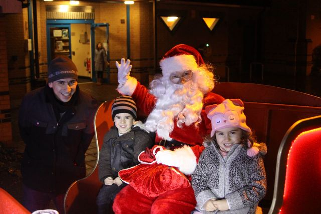 Children were mesmerised by Father Christmas. Image via Round Table Facebook page.