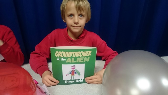 Oscar Reid proudly shows off his CMP book (image supplied by Kate Day)