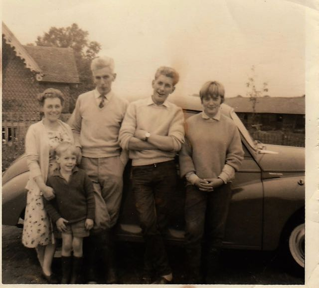 My dad, Mum, Heather, Brother Simon and me Probably around 1960/61. All leaning against my lively Morris Minor.