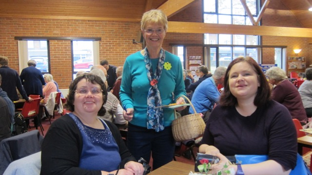 Jennifer (centre) with her basket - selling raflle tickets at The Coffee Room. With Chandler's Ford authors: Allison Symes (left) and Emma Golby-Kirk.