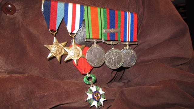 War medals worn by Frank Damerell, including the Legion d'honneur medal (in green and white) awarded by the French government.