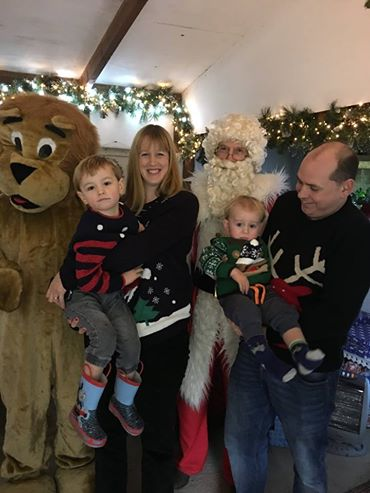 Lucas (aged 2) and Ethan (aged 1) with Santa at Brambridge Garden's Santa Grotto.