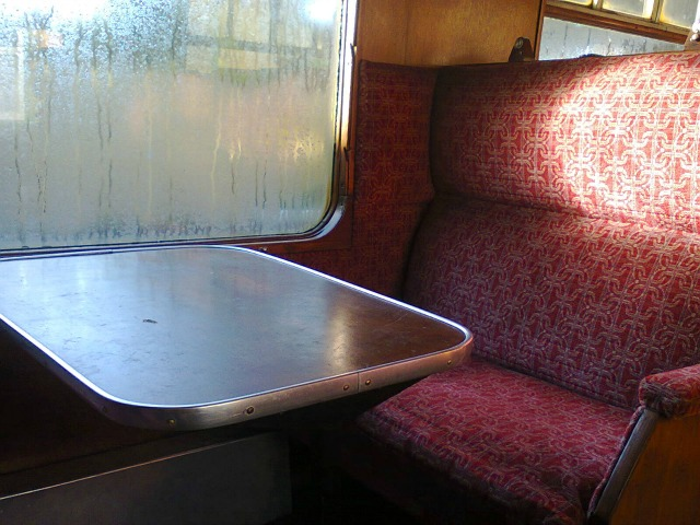 Typical steam train seating - note condensation on window