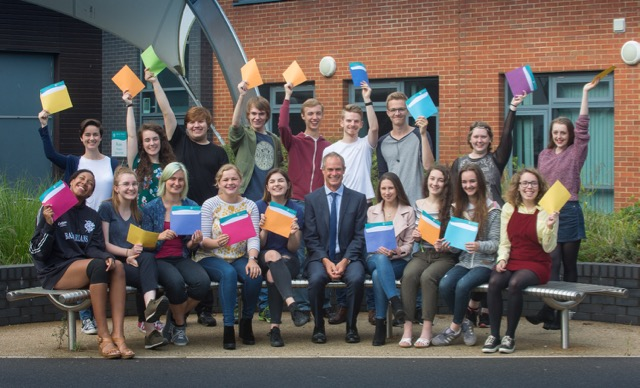 Barton Peveril students celebrate great results with Principal, Jonathan Prest.