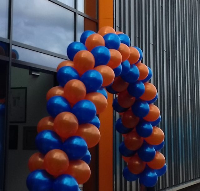 orange and blue balolons at the entrance