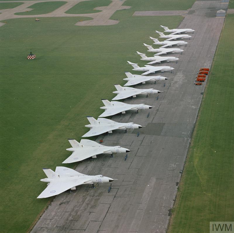 The Royal Air Force, 1950-1969 (RAF-T 5323) Six Avro Vulcan B.2 aircraft of No 617 squadron and six Handley Page Victor B.2 aircraft of either No 100 or No 139 Squadron (from RAF Witttering) lined up at RAF Scampton. These Vulcans and Victors are painted in their 'anti-flash' white paint-scheme. Copyright: © IWM (RAF-T 5323)