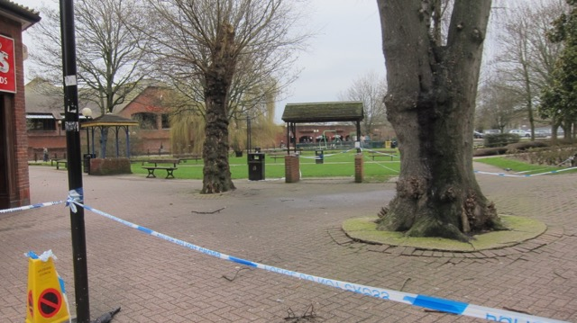 The bench has been removed, and the park is cordoned off.
