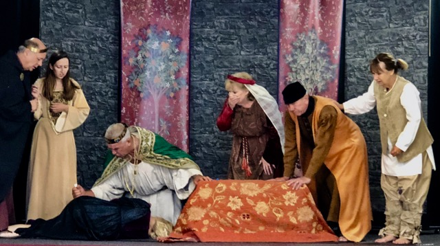 A dramatic event unfolding in both King Lear and the play