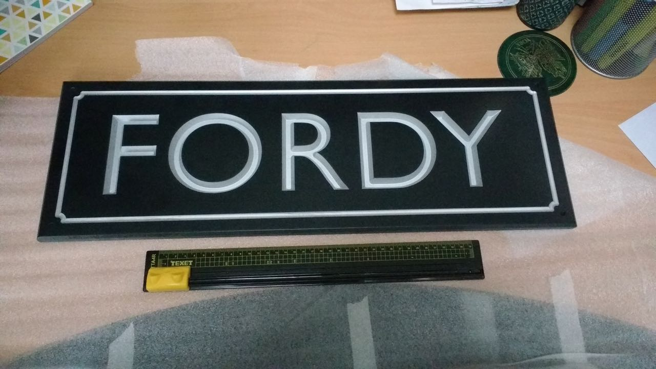 Sign for Fordy, wooden train planter at Chandler's Ford station.