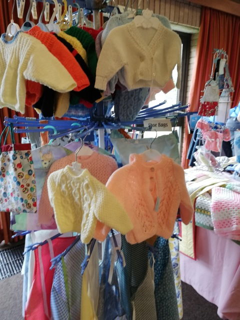 Lots of knitted and crocheted clothing, and practical handmade textile items for home and gardens.