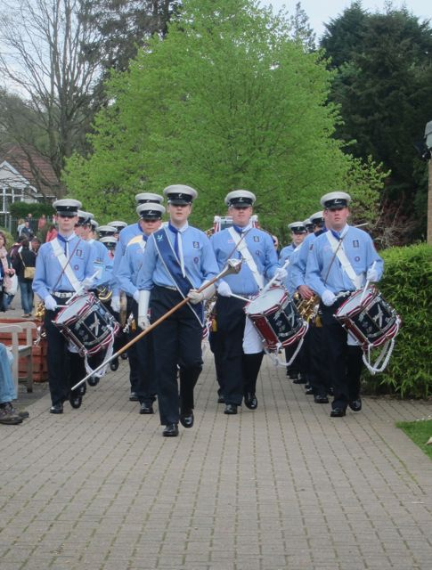 Spitfires Scout Marching Band entering Merdon Junior School.