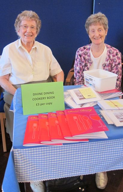 Deirdre and Mavis: selling Divine Dining at St. Martin in the Wood (craft and cake fair).