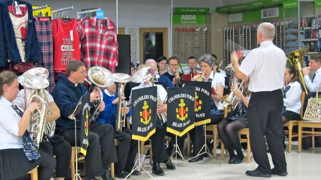 "Are you ""Too cool to Yule""? Chandler's Ford Brass Band playing at Asda."