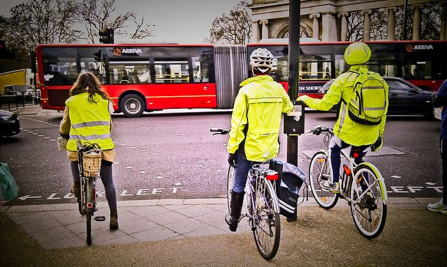 Cyclists in London staying safe by wearing high-visibility jackets. Image by Garry Knight via Flickr.