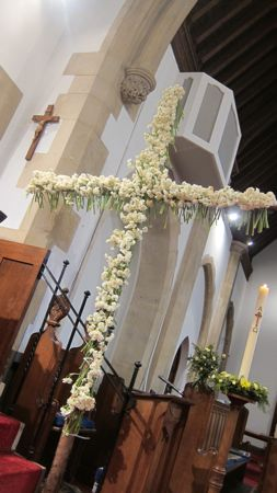 Cross beautifully decorated with daffodils at St. Boniface Church.